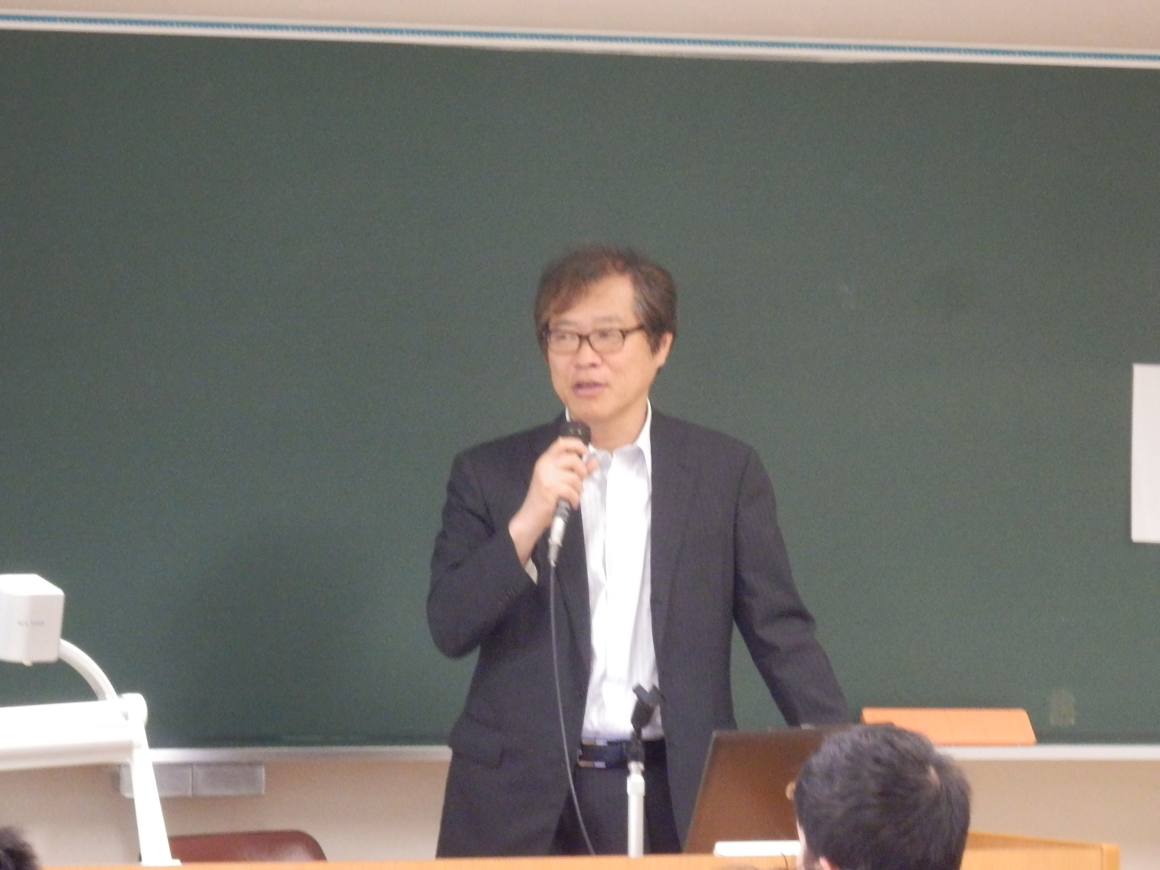 講師の西山巨章氏